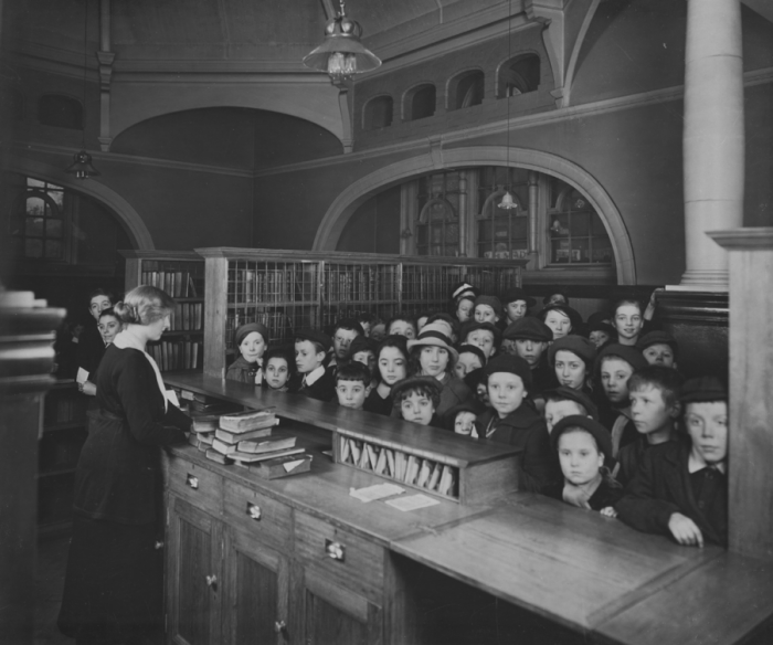 View of Kensington Library showing children waiting at the library counter in April 1917