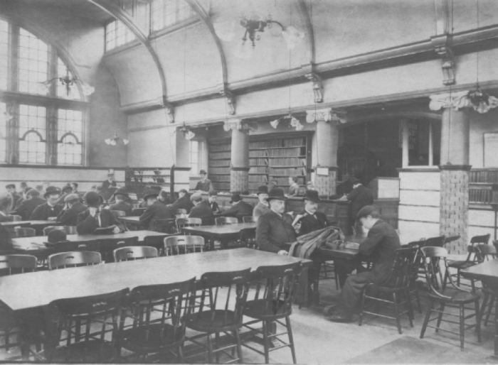 View of Kensington Library showing the reading room in January 1917. It's interesting to notice the fashion of the day, with nearly all the gentlemen wearing hats.