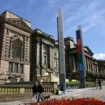 national museums liverpool - world museum with a blue sky and red flowers in the foreground