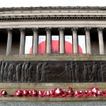 St George's Hall with the cenotaph outside and red poppy wreaths
