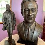 Photograph of the Brian Epstein bust and statue featured in article