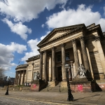 Walker Art Gallery against a blue sky with white clouds