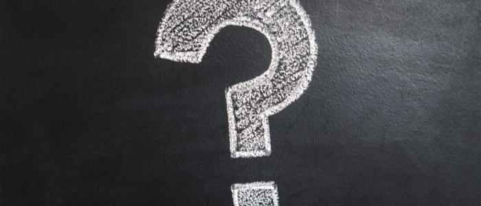 chalk question mark on a blackboard