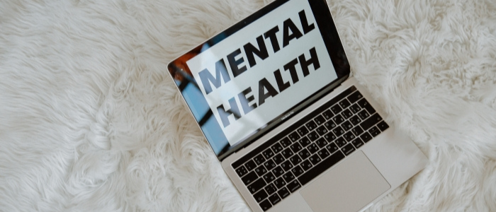 laptop with words MENTAL HEALTH on screen