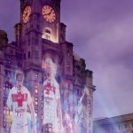 royal liver building llt in purple with rugby p;layers projected onto it