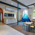inside bluecoat hub with chairs and tables and artwork installation