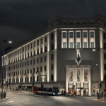Lewis' building lit up at night for LightNight