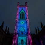LightNight at Bombed out church featuring the church tower at night lit up in blue and purple