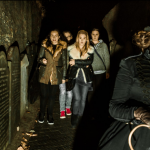 shiverpool actress leading a group of people past grave stones