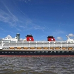 disney cruise vessel in front of the liverpool waterfront at cruise liverpool
