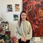 Kiki Xuebing Wang in art gallery