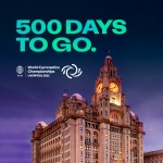 graphic of the words 500 days to go in green against the liverpool liver birds in background with the world gymnastics logo