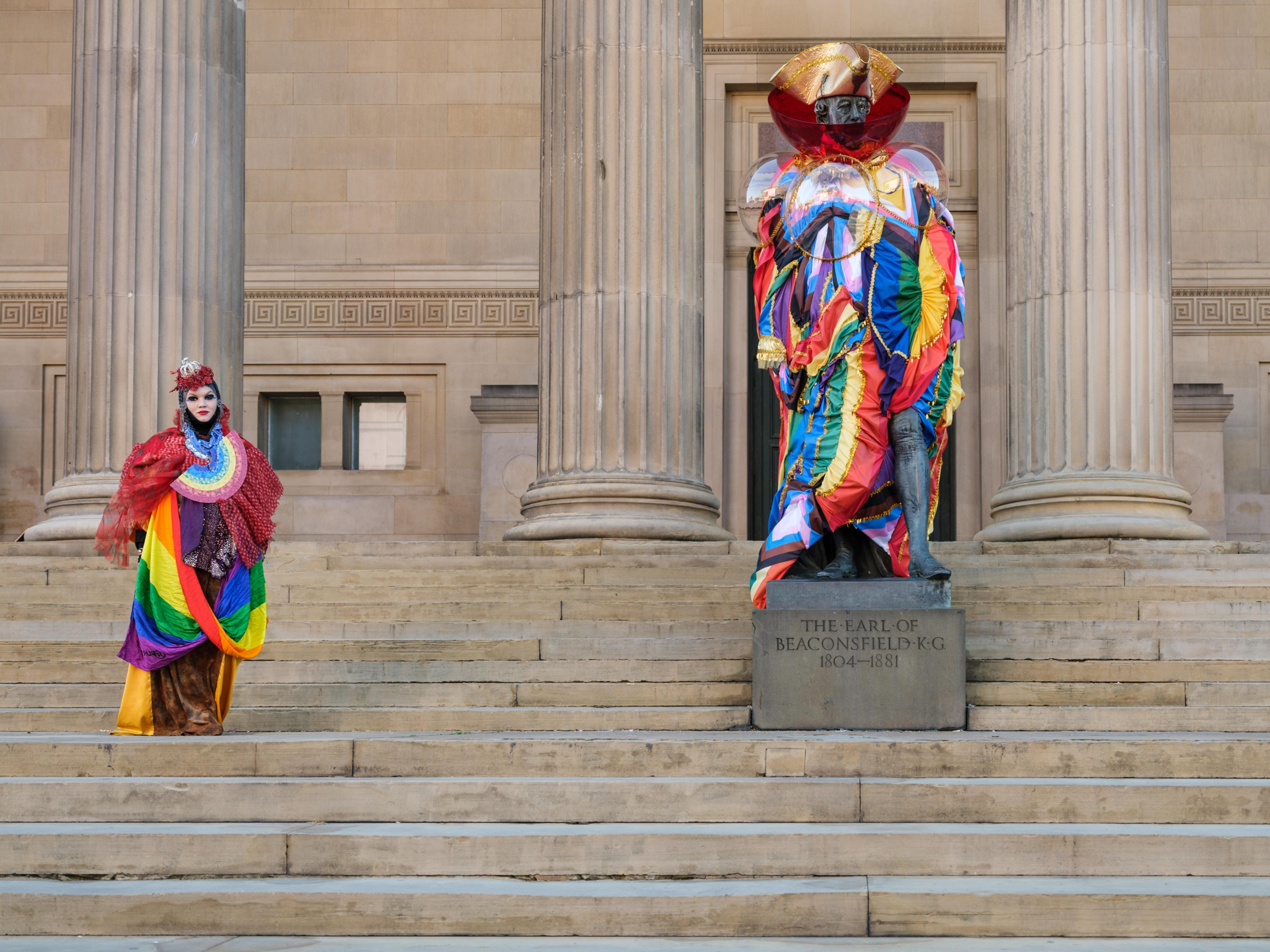 statue outside St georges hall dressed in bright colours