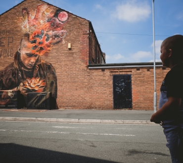 St Helens community unveils two new murals created by internationally renowned street artists Nomad Clan celebrating its past, present and future.