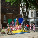 bluecoat outdoor sculpture with children and an performer