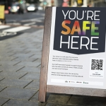 a board with artwork displayed saying you're safe here