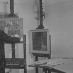 exhibition at bluecoat photograph in black and white of a man standing at an easel with a painting on it