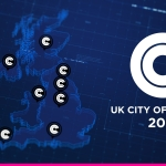 blue image of the UK map with dots on uk cities with white circle saying UK city of culture 2025