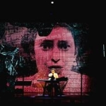 halloween performance at everyman playhouse with giantprojection of a lady across the back wall