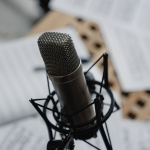 microphone on a table with blurred music papers in background